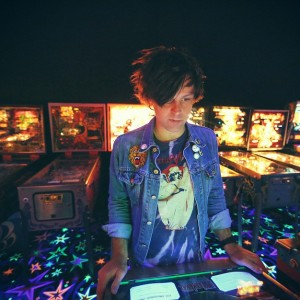 Adams with one of his loves: pinball. Image: Alice Baxley