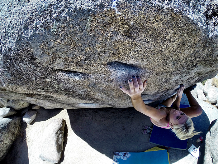 Blair-Coyle scales a boulder during one of her outdoor climbs.