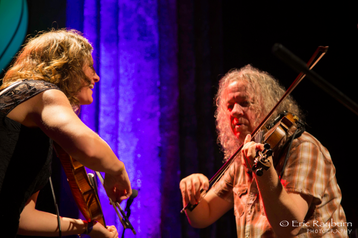 Jenni Charles (left) of Dead Winter Carpenters with Tim Carbone of Railroad Earth during a performance December 31, 2013, Asheville, NC. Image: Rayburn