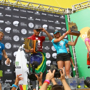 Filipe Toledo (L, red) and Courtney Conlogue (R, blue) celebrate winning the Oi Rio Pro and Oi Women's Rio Pro in Barra da Tijuca, Rio de Janeiro, Brazil. PHOTO: WSL