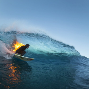 Jamie O'Brien surfs whilst lit on fire, at Teahupoo, Tahiti on 21 July, 2015. PHOTO: Ben Thouard / Red Bull Content Pool